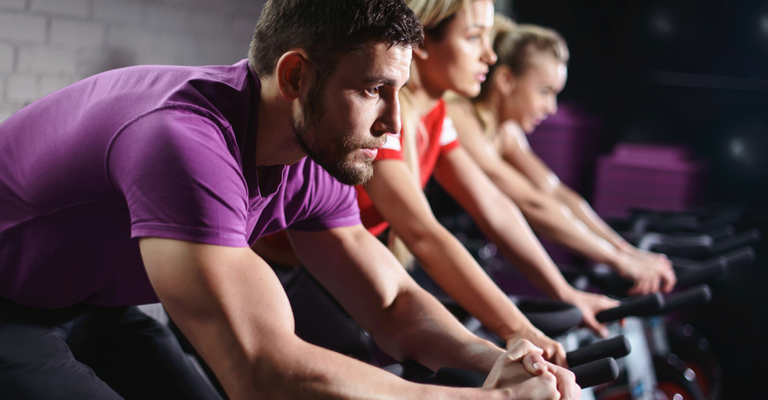 An indoor cycling class