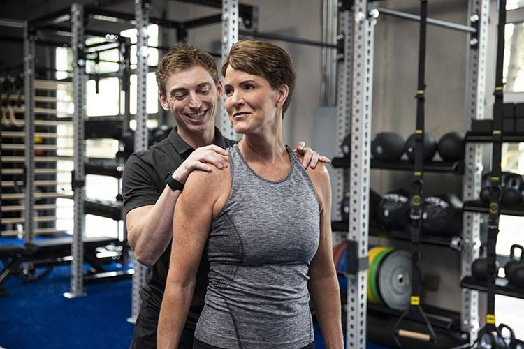 professional assisted stretching. Professional assesses shoulder mobility