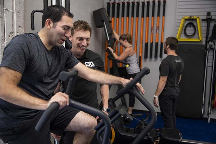 stretch professionals assist clients in workout