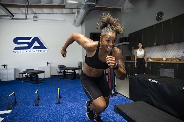 athletic client mid sprint in gym